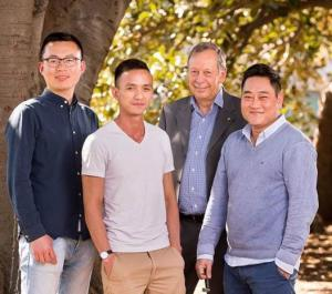 Shuai Li, Jack Trinh, Prof John Hopper and Dr Kevin Nguyen standing together